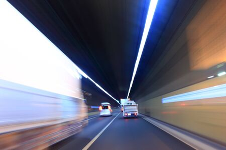 Heavy truck in a tunnel Stock Photo