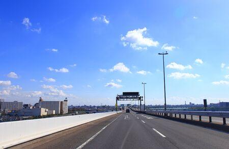 Car driving on metropolitan expressway