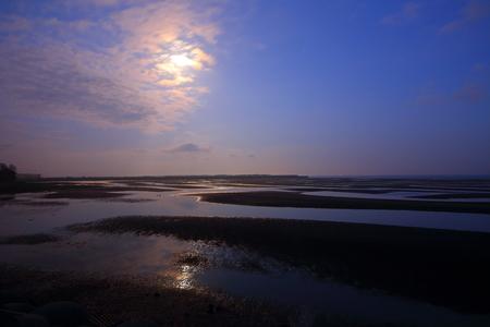 ebb: Moonlight beach at ebb tide