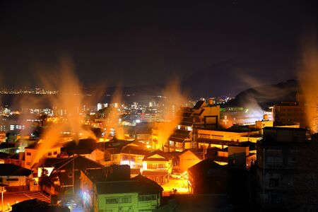 The steam nightscape of Beppu Stock Photo