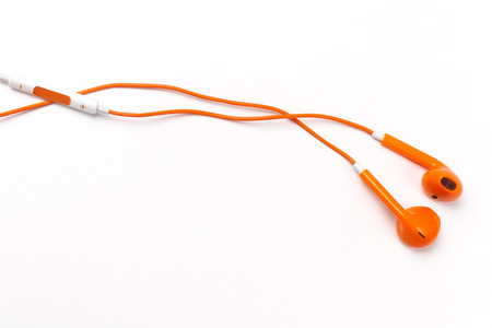 Orange earphones isolated on white background Stock Photo