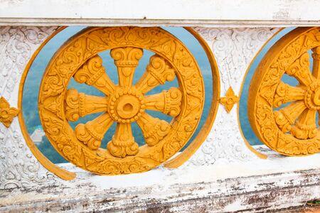 dhamma: Wheel of dhamma of buddhism. Stock Photo
