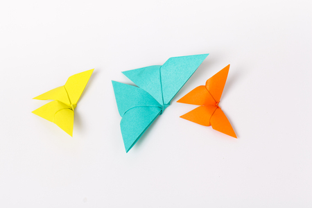 origami: colourful origami butterfly paper on withe background.