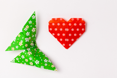colourful origami butterfly paper with red heart origami on withe background. Stock Photo