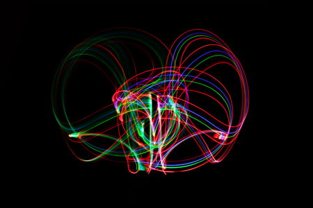 abstract neon light painting on black background. Stock Photo