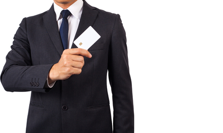 suite: Businessman in black costume suite put or take out credit card in pocket. Stock Photo