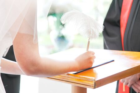 Bride to sign a marriage certificate