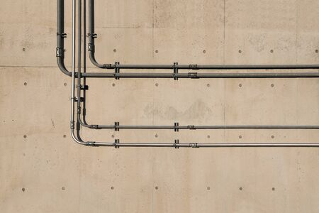 Concrete wall and metal plumbing