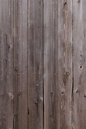 an old wooden wall with wood grain 写真素材