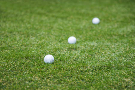 Golf balls and artificial lawns