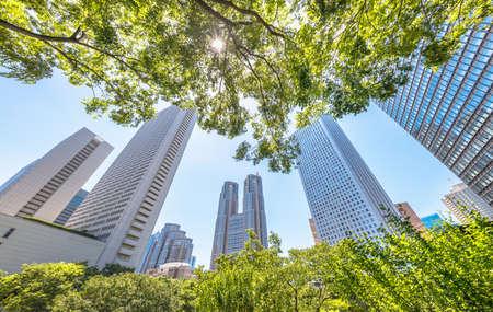 Nishi-Shinjuku high-rise buildings with beautiful fresh green Stock Photo