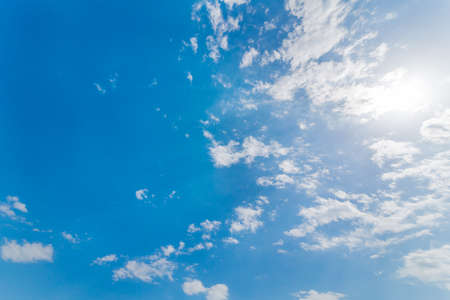 Blue sky, clouds and sun Imagens