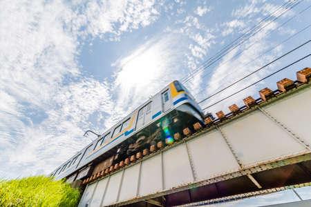 A local line in the suburbs of Yokohama crossing the iron bridge