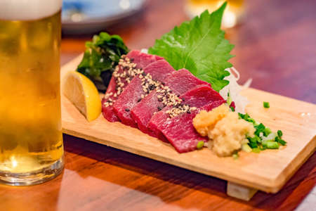 Horse sashimi and beer