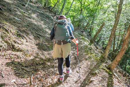 People hiking on mountain trails