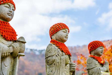 Jizo-san in the autumn leaves