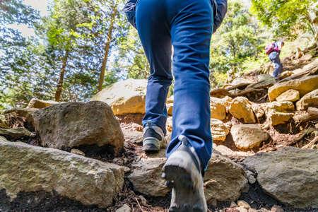a person who walks on a mountain trail Archivio Fotografico