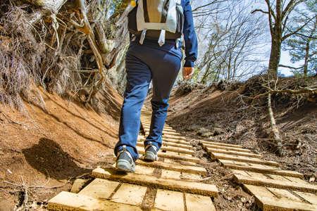 man walking on a mountain trail