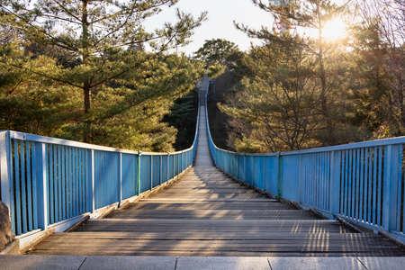 Blue suspension bridge with beautiful sunset