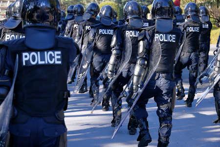 Riot police march training scene Standard-Bild