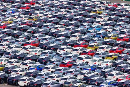a lot of aligned cars waiting to be loaded