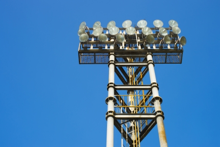 electricity pole: metal stadium lights for sport game with beautiful blue sky