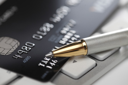 Concept of online shopping with pen, keyboard and credit card
