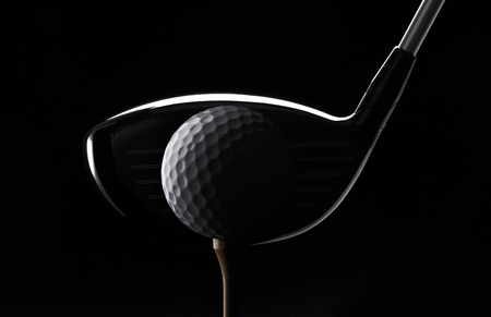 Golf ball club and tee on black background Standard-Bild