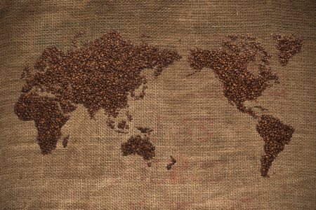 coffee beans: Wold map made of coffee beans on textured background