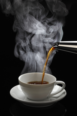 hot coffee: Pouring hot coffee