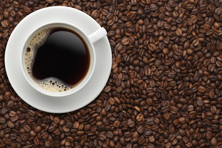 drink coffee: Cup of coffee on beans