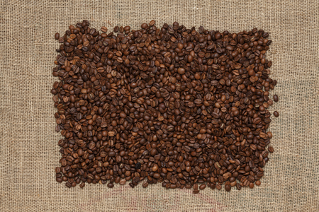 coffee sack: Coffee beans on a jute background Stock Photo