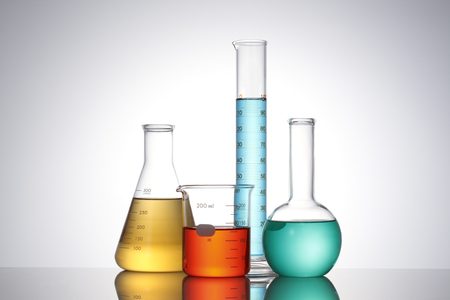 Laboratory glassware with liquids of different colors