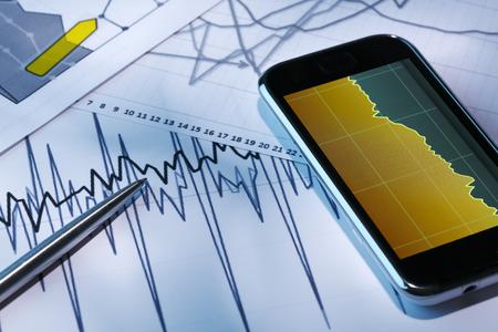 market analyze: Market Analyze and Pen and smartphone on a chart.