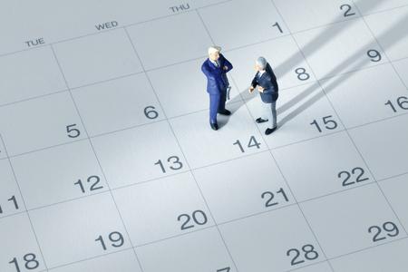 calendrier: Homme d'affaires sur le calendrier Banque d'images