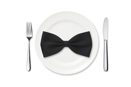 dinner wear: Dinner plate with silverware and bow tie