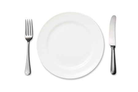 Dinner plate, knife and fork on white background
