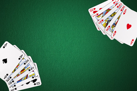 games hand: playing cards on green felt with copy space for background use Stock Photo