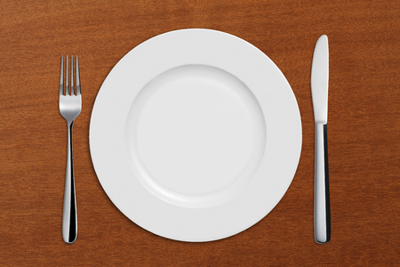 dinne: Dinner Plate, Knife and Fork on wooden background
