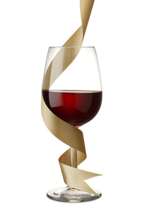 christmas meal: Red Wine with Gold Ribbon on Whiteclipping path Stock Photo