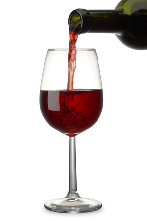 Pouring Red Wine with clipping path Banco de Imagens