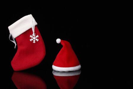 stocking cap: Santa Hat and Christmas Stocking on black background
