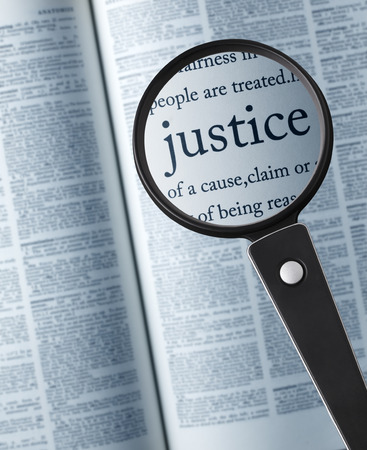 scrutinize: JusticeMagnifying glass on the justice in dictionary