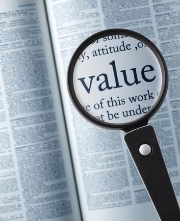 values: ValueMagnifying glass on the value in dictionary Stock Photo