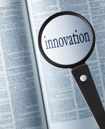 InnovationMagnifying glass on the innovation in dictionary