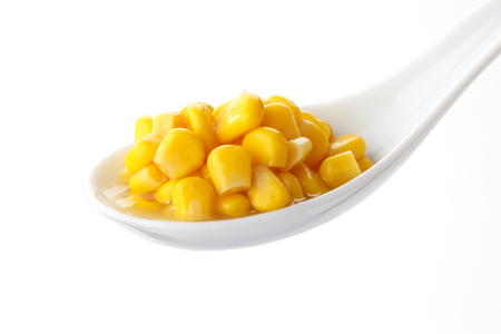spoons: Corn on spoon Stock Photo