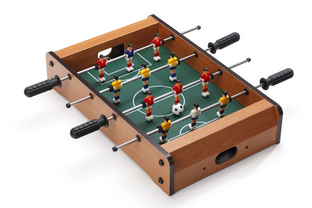 Table soccer  Football players on the grass field background. Table game. Banco de Imagens