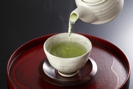 japanese green tea: Japanese green tea in porcelain cup and tea pot.