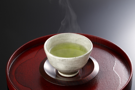 horizontal  green: Japanese green tea in porcelain cup Stock Photo