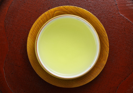 japanese green tea: Japanese green tea in porcelain cup Stock Photo